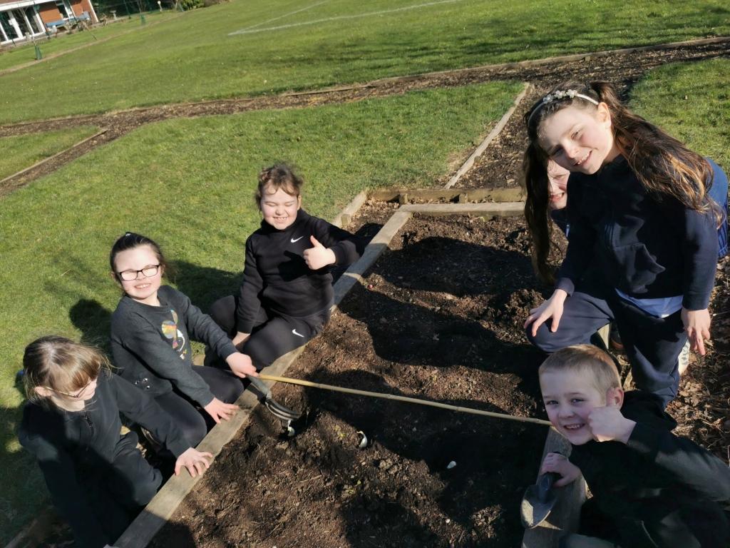 Happy smiling children in school garden
